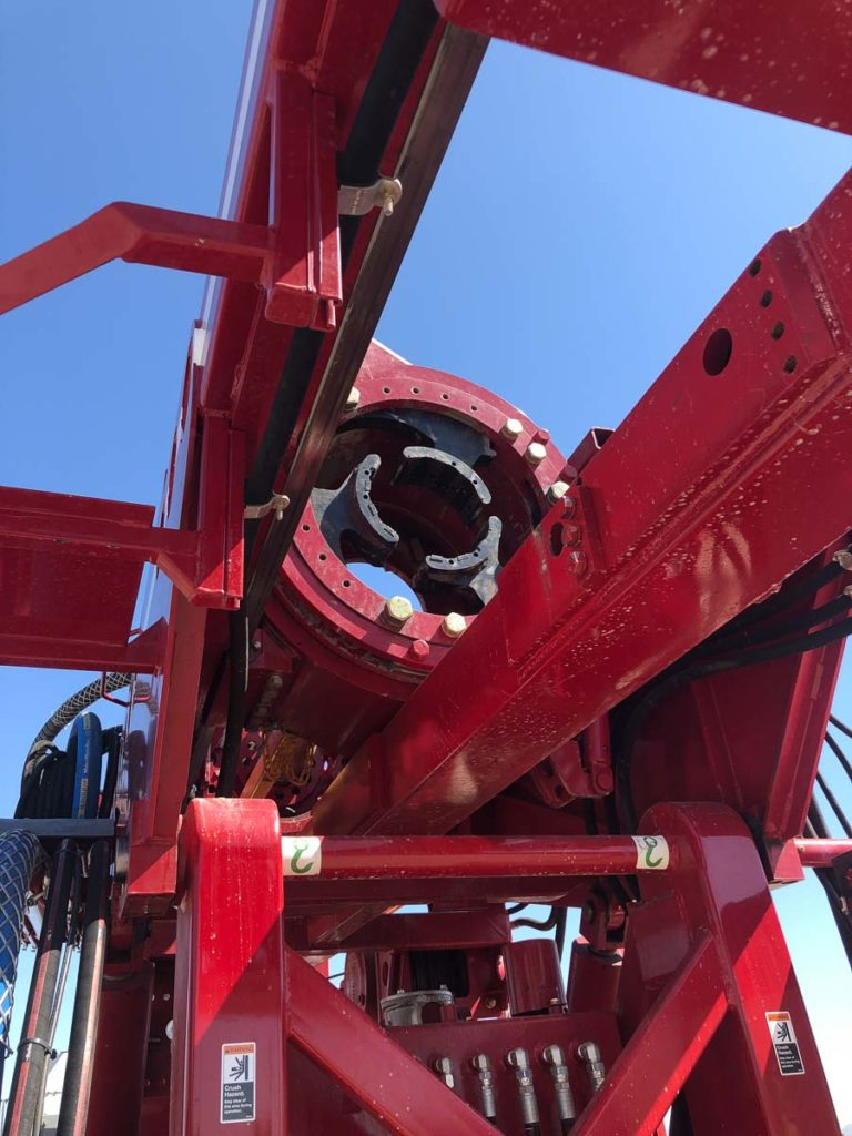 Red well drilling truck for water wells