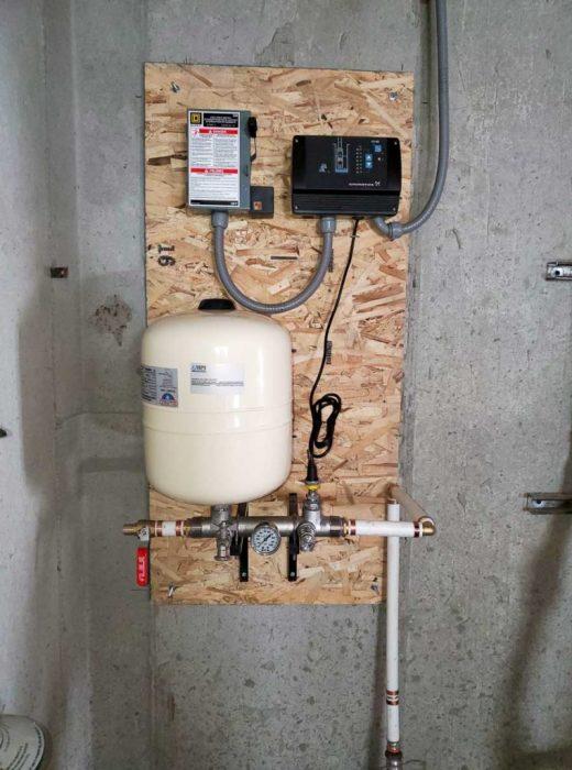 Water well pump system in garage